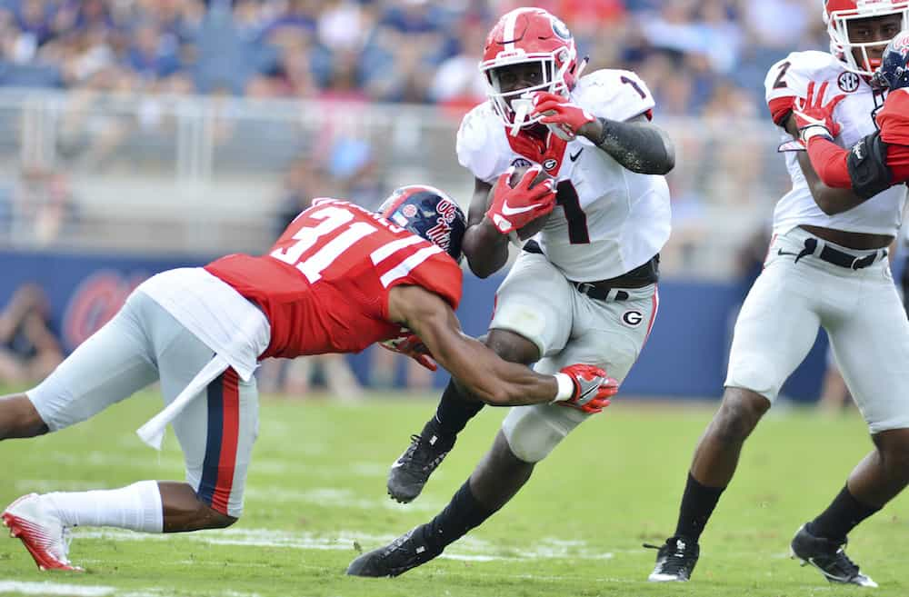 Sep 24, 2016; Oxford, MS, USA; Georgia Bulldogs running back Sony Michel (1) attempts to avoid Mississippi Rebels defensive back Jaylon Jones (31) during the third quarter of the game at Vaught-Hemingway Stadium. Mississippi won 45-14. Mandatory Credit: Matt Bush-USA TODAY Sports